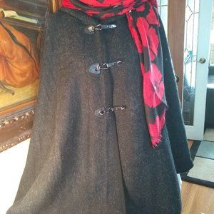 Cape with hood and toggle closure